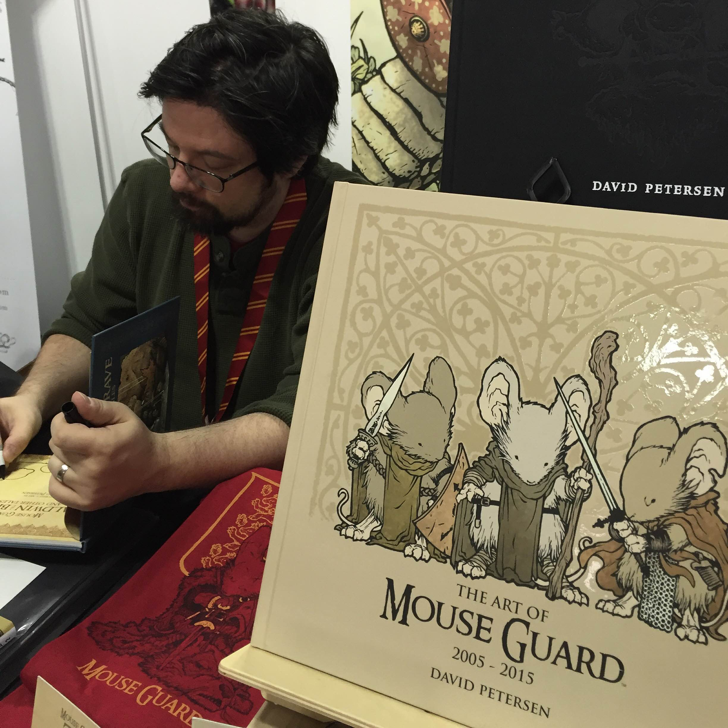 It's impossible to walk past David Petersen's Mouse Guard booth and not  stop to look at the amazing selection of work. Mouse Guard is celebrating  it's 10th ...