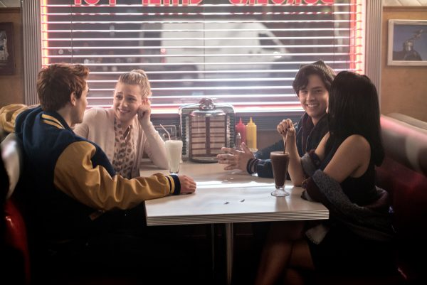 """Riverdale -- """"Chapter Two: A Touch of Evil"""" -- Image Number: RVD102a_0178.jpg -- Pictured (L-R): KJ Apa as Archie Andrews, Lili Reinhart as Betty Cooper, Cole Sprouse as Jughead Jones, and Camila Mendes as Veronica Lodge -- Photo: Diyah Pera/The CW -- © 2016 The CW Network. All Rights Reserved"""