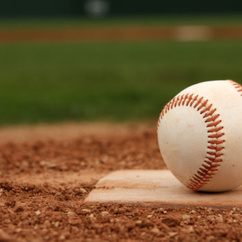 Baseball on Home Plate -- David Lee/Shutterstock.com