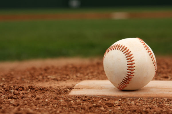Baseball on Home Plate -- David Lee/Shutterstock.com